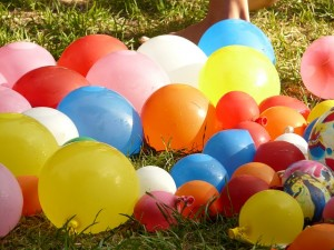 When you just can't seem to get away from the kids, have some fun. Show them how to have a proper water balloon fight.