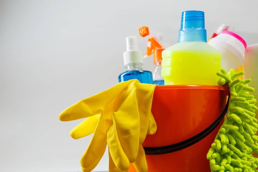 58310273 - bucket with cleaning items on light background