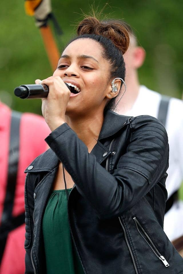 "The 29th annual broadcast of the National Memorial Day Concert, which airs tonight at 8 p.m. ET, opens with"" The Voice"" Season 14 finalist and military brat Spensha Baker singing the National Anthem."